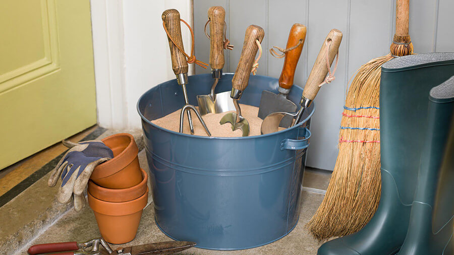 gardening tools in sand